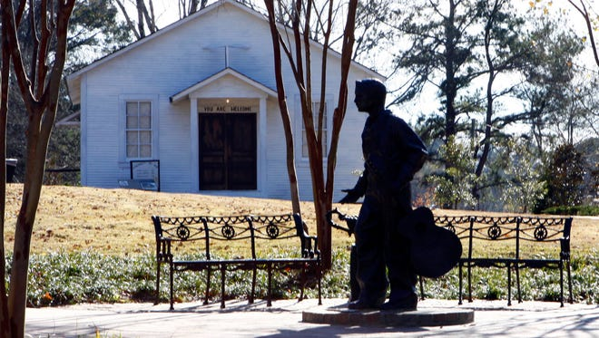 A statue of a 13-year-old Elvis Presley stands before the church he attended as a child in Tupelo, Mississippi.