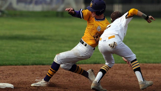 Bloom-Carroll's Cooper Vest is tagged out by Buckeye Valley shortstop Evan Ulrich during Thursday's game, May 11, 2017, at Bloom-Carroll High School in Carroll. The Bulldogs won the game 7-0.