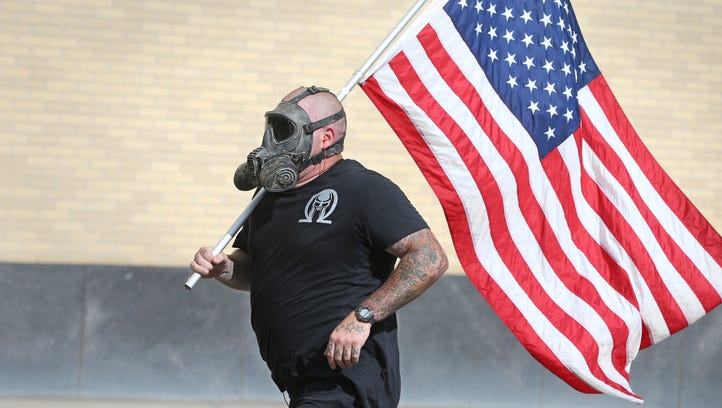 Darth Vader of Canandaigua, carries the American flag