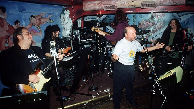 Slaves  of New Brunswick guitarist Bernie Brausewetter (left), Donna Dior (top) Tony Shanahan (back to camera), Matt Pinfield (middle) and Jack Shepherd (right) upstairs at The Melody Bar, New Brunswick in 1991.