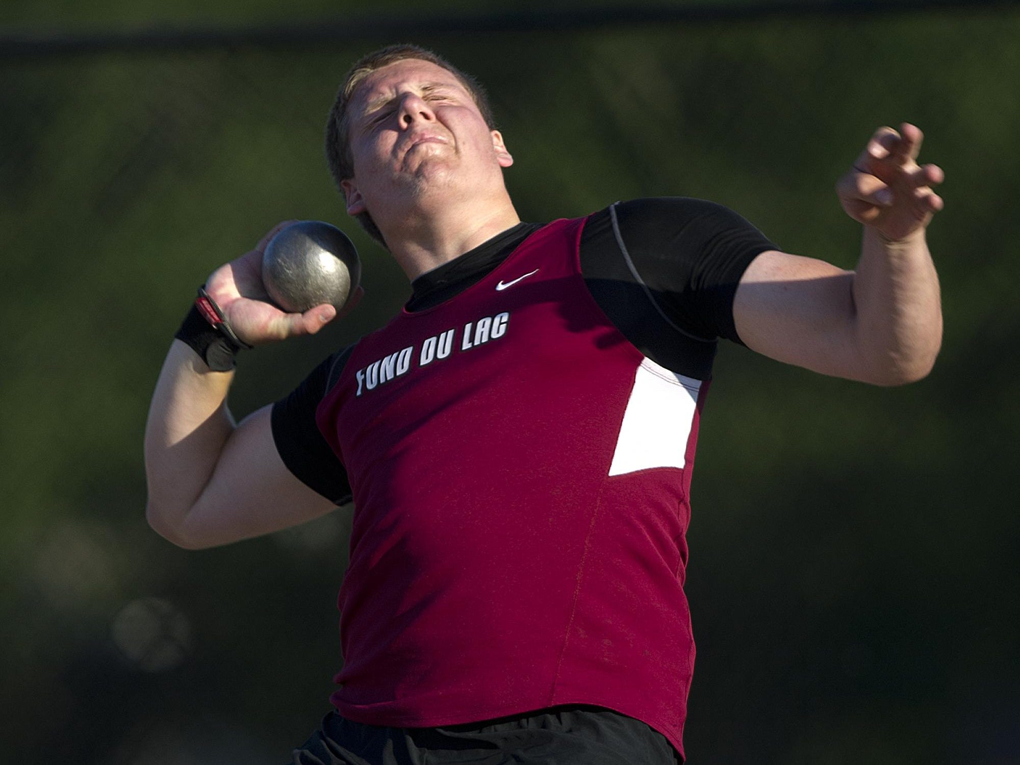 Fond du Lac's Peter Andrew competes in the shot put at Friday's WIAA Division 1 state track and field meet.