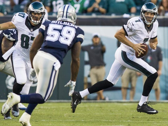 Eagles quarterback Sam Bradford roles out of the pocket during the Eagles 20-10 loss to the Dallas Cowboys in Philadelphia on Sunday afternoon.