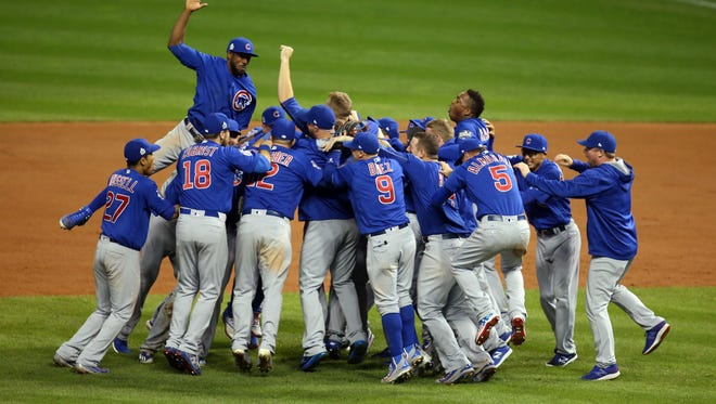 Chicago Cubs players celebrate after defeating the Cleveland Indians in game seven of the 2016 World Series at Progressive Field.