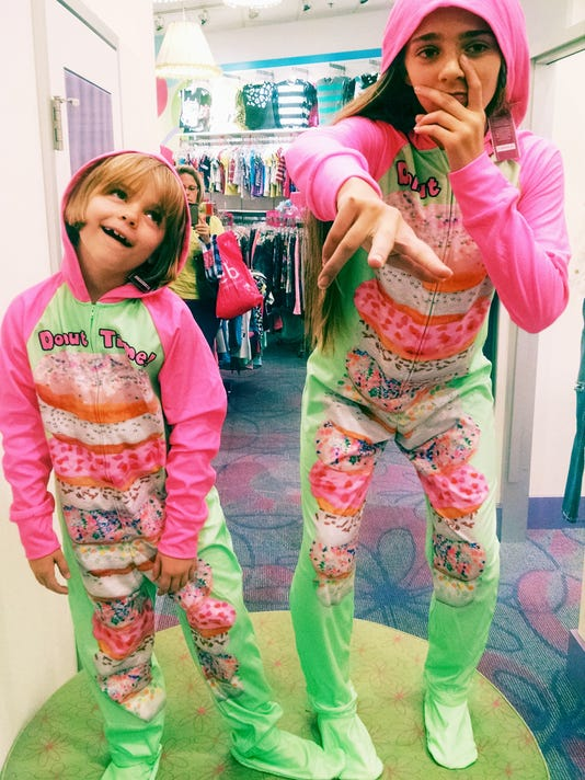 Couple of doughnut lovin' bozos put on a fashion show at Justice in the Galleria Mall.