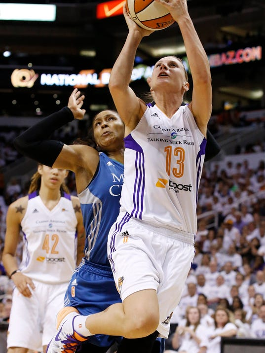 Phoenix Mercury's Penny Taylor (13), of Australia, scores against Minnesota Lynx's Maya Moore, as Mercury's Brittney Griner (42) watches during the second half in Game 1 of the WNBA Western Conference finals Friday, Aug. 29, 2014, in Phoenix. The Mercury defeated the Lynx 85-71. (AP Photo/Ross D. Franklin)