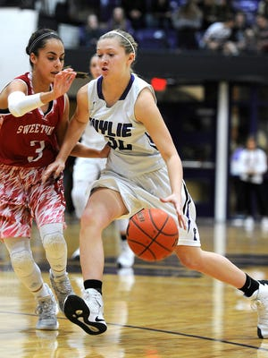 Wylie's Skylar Williams (32) drives to the basket while being guarded by Sweetwater's Brianna Moriel (3) during the fourth quarter of the Lady Bulldogs' 35-30 win on Friday, Jan. 20, 2016, at Wylie High School.
