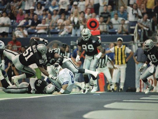 Aaron Wallace Sr. (33), seen here hitting Dallas quarterback