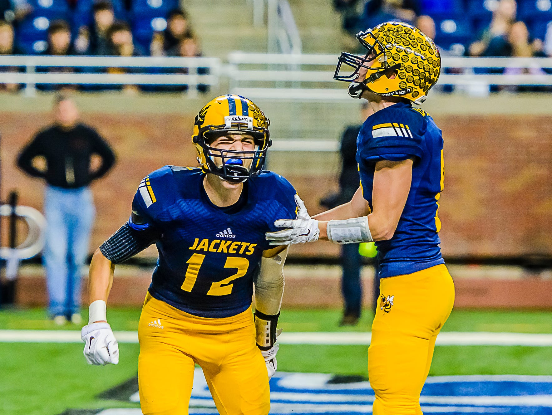 Spence DeMull ,12, of Ithaca celebrates with teammate Colton Campbell after DeMull scored late in the 3rd quarter to tie the score at 13.
