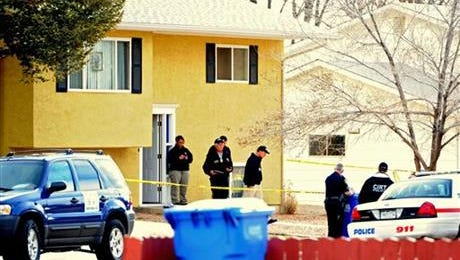 Canon City police are pictured at a home on Monday, March 10, 2014, as they investigate the deaths of a mother and two young children found at the home Sunday night. Police said Jaacob Van Winkle has been arrested and charged in the murders. Police were responding to a report of a sexual assault from a teenage girl when they found the bodies. Byerly said the girl escaped and ran to a neighbor's home to notify police.