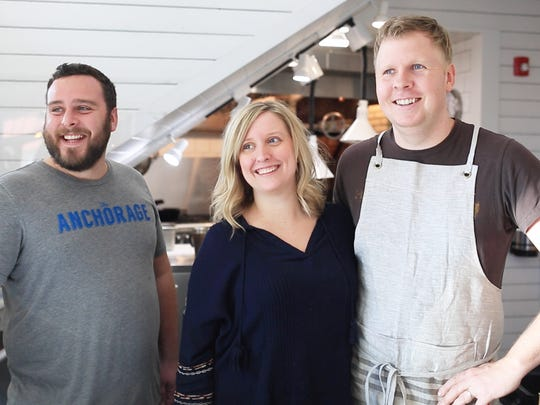 The Anchorage's general manager Nick McSherry, Beth McPhee, and her husband, owner and executive chef Greg McPhee, stand for a portrait Thursday in Greenville.