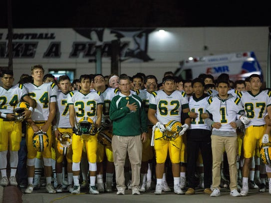 The Mayfield High School Trojans prepare to walk out