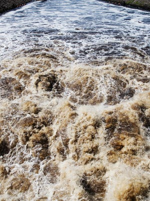 Water gushes out of the locks in Ortona on Monday, Oct. 16, 2017. The U.S. Army of Corps of Engineers is releasing water from Lake Okeechobee because of high levels.