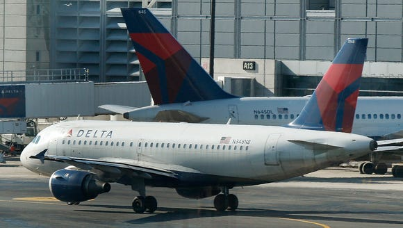 A Delta Air Lines plane taxis at Boston Logan Airport