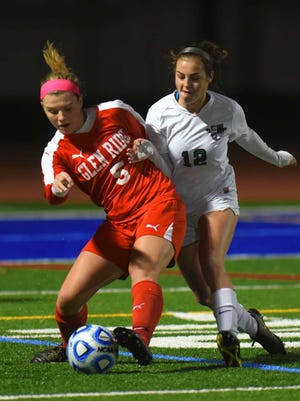 Glen Ridge's Colleen Grady protects the ball from Kinnelon's Paige Hanley during the Group 1 soccer state semifinals last season.