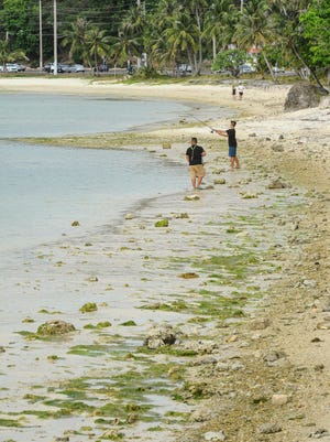 In this Pacific Daily News file photo, ocean recedes away the high watermark and transistion into a low tide as two fishermen try their luck at catching fish along the shoreline of East Agana on Wednesday, April 13, 2016.