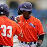 Northwestern State's Nick Heath is congratulated by Cort Brinson during Friday's game.