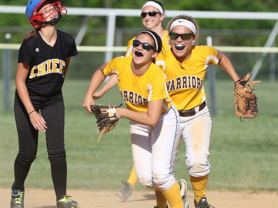 Piscataway's Ellz Posada (2), left, reacts as Watchung Hills' Tina Zoppi (20), center, and Brooke Aldrich (1), right, celebrate the last out in a 6-2 win in the North 2 Group IV sectional final in Warren on June 2, 2016.