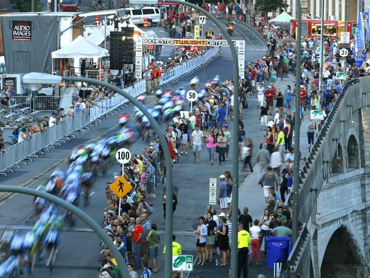 Cyclists pass the starting and finish line on Broad