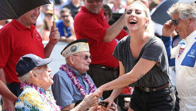 Lady Gaga jokes with a survivor of 1941's Pearl Harbor attack before today's Indianapolis 500.