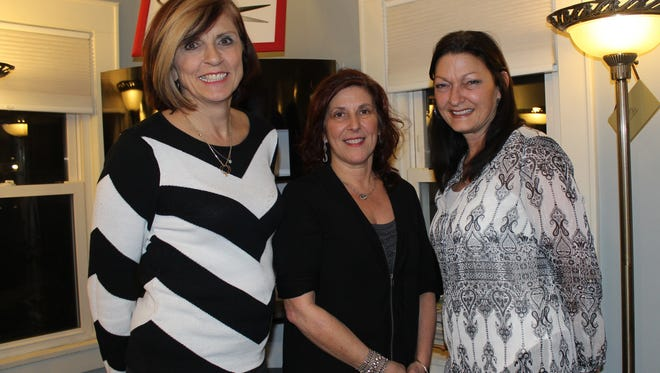 From left, Lee Ann Adolf, AnnaMaria DeNinis and Gia Bryan are the owners of Gallery 2 Twelve in Vestal.