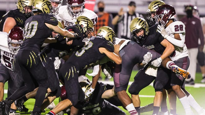 Andover Central's defense made a stop on third down against Salina Central in the third quarter on Friday, Oct. 9 at Jaguar Stadium