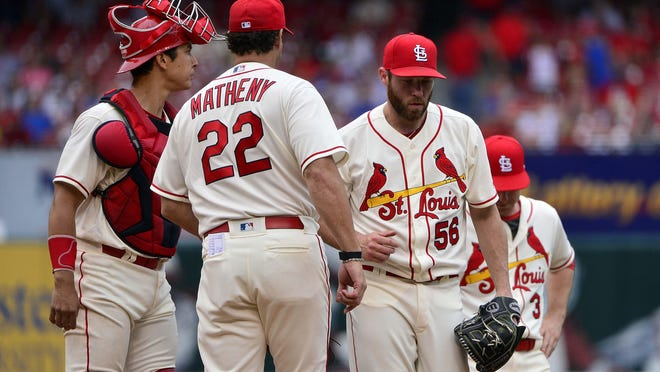Current Royals manager Mike Matheny (22) pulls relief pitcher Greg Holland (56) from the game in May 2018 during their fateful previous stints with the St. Louis Cardinals. Both are looking for redemption now with the Kansas City Royals, where Holland appears to have returned to the All-Star closer form that helped guide the Royals to back-to-back World Series in 2014 and 2015.