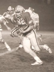 The 1986 Purcell Marian MVP Jay Koch carries the ball.