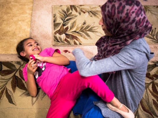 Mariam Shukri, 6, plays with her mother, Mufida Ammar, on Thursday, February 2, 2017 in Clemson.