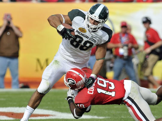 MSU tight end Brian Linthicum picks up a key first down late in the game during MSU's comeback against Georgia during the Outback Bowl in Tampa, Florida, Monday, 1/12/2012