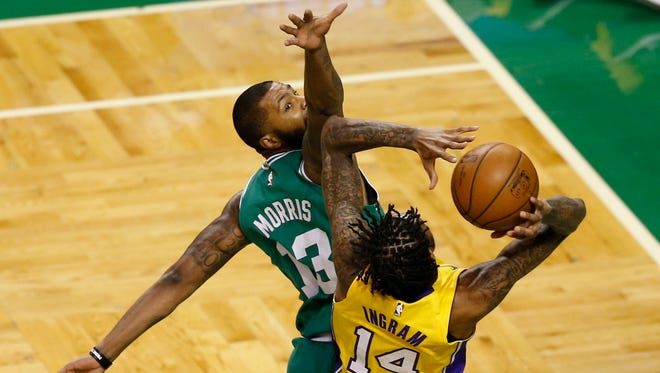 Los Angeles Lakers guard Brandon Ingram, right,  is defended by Boston Celtics forward Marcus Morris during the first half at TD Garden.