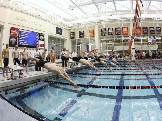 The starting blocks at Bucknell's Kinney Natatorium as York Suburban's Alex Fridman, left, dives into the water to start a relay during 2014 championships.