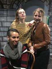 """Katie Chesebro (standing, left) as Stepsister Nella, Liza Chesebro as Stepsister Della and Desiree Lara-Balicki (seated) as Stepmother rehearse a scene from """"Cinderella: The Untold Story."""""""