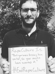 "Our VOICE Client Services Coordinator Jerry Kivett made a sign that said ""Rape Culture is...'But you were kissing him earlier so you must have wanted it.' #endrapeculture."""