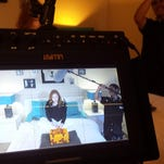 """The crew sets up a scene on the short film """"Binaural"""""""