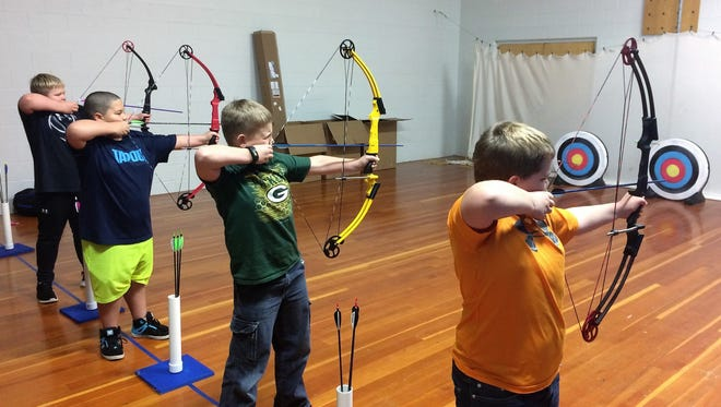 Oconto Middle School students Jacksen Cota, Nate Beekman, Seth Miller, and Chase O'Mary take aim at downfield targets during an archery class this past semester.