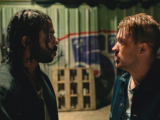 "Daveed Diggs, left, and Rafael Casal and in ""Blindspotting,"""
