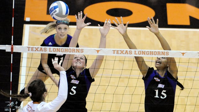 Northwestern State's Ashley Elrod (1), Mackenzie Neely (5) and Vanessa Coleman (15) defend against an attack from Texas outside hitter Paulina Prieto Cerame during the second-seeded Longhorns' win over NSU in the first round of the NCAA tournament on Thursday.