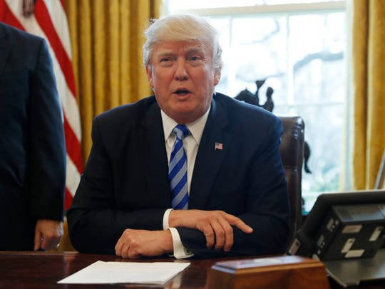 President Donald Trump meets with members of the media
