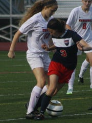 Franklin's Riley Burnette defends a Churchill player during a game last season.