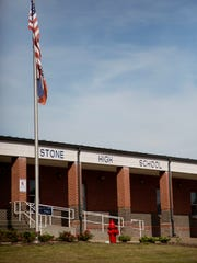 """Stone County High School in Wiggins, Miss., is seen Monday, Oct. 24, 2016. The state NAACP says white students at Stone County High School threw a noose around the neck of a black student and """"yanked backward"""".  Ayana Kinnel, spokeswoman for the civil-rights group, says Monday that the incident took place the afternoon of Oct. 13 at the Stone County High School field house in Wiggins. The civil-rights group is calling on the school to expel the white students."""