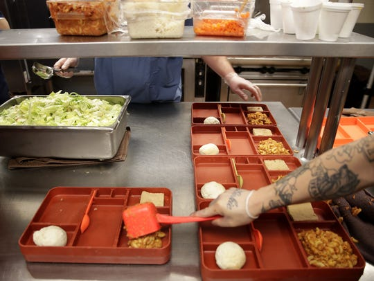 Inmates at the Outagamie County Jail prepare lunches last week. Danny Damiani/USA TODAY NETWORK-Wisconsin