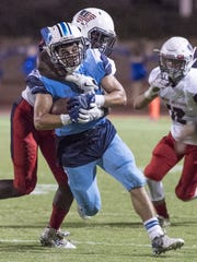 Redwood's Gabe Vasquez tries to escape Tulare Western's