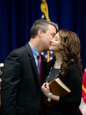 Steve Marshall kisses his wife, Bridgette Marshall, after becoming the Alabama Attorney General as on Monday, Feb. 13, 2017 in Montgomery, Ala.