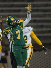 Carver's Anthony Scott celebrates after a sack during