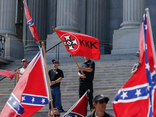 Members of white supremacists groups rally on the steps
