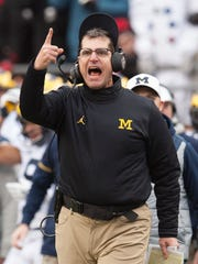 Michigan coach Jim Harbaugh shows his displeasure with a personal foul call against the Wolverines that nullified a big gain by RB De'Veon Smith late in the third quarter.