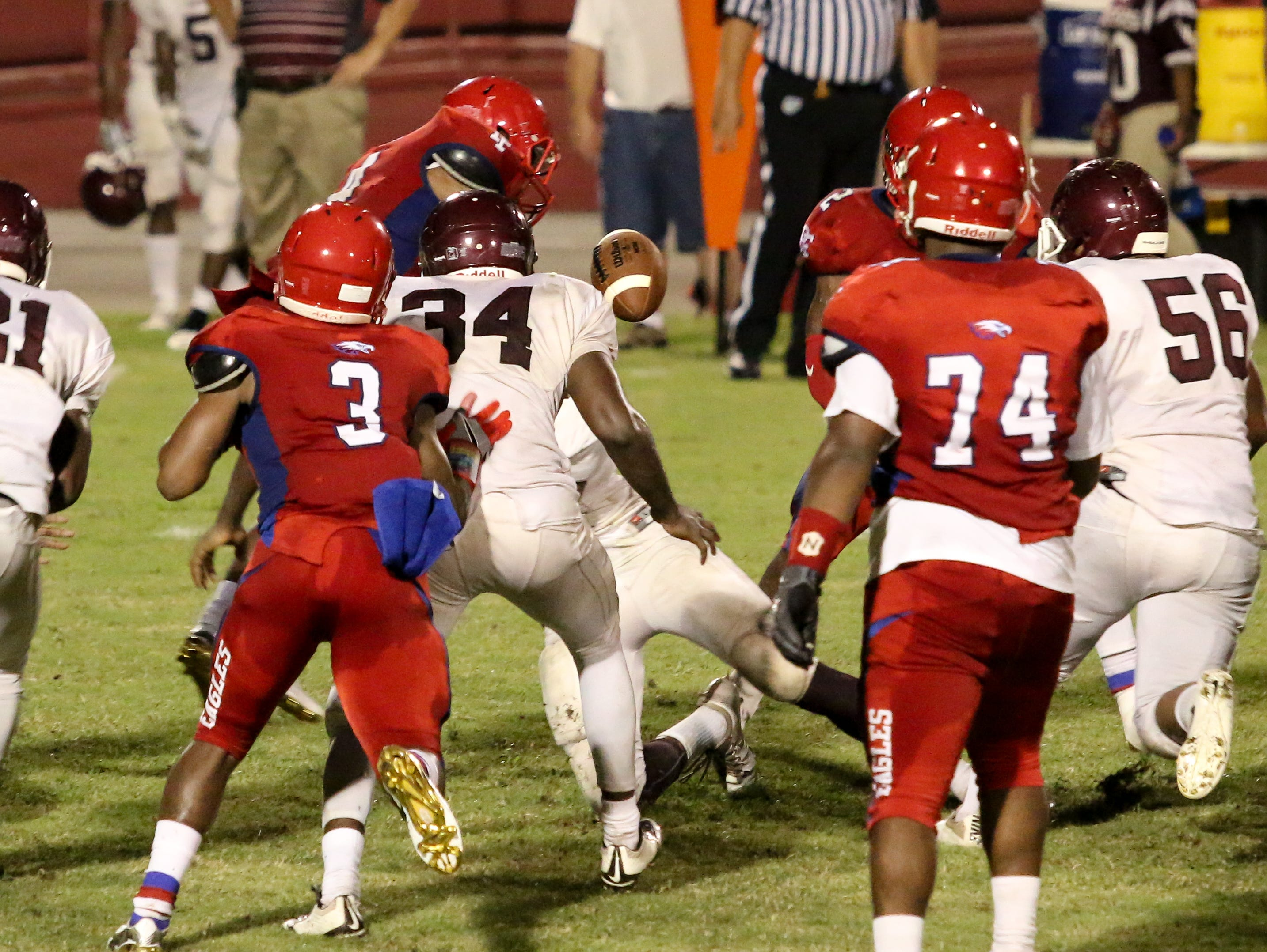 The ball popped out after Pine Forest's Ladarius Wiggins (4) was hit hard by a Pensacola defender Friday night at Pine Forest High School.
