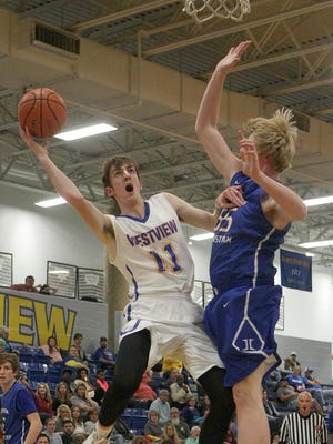 Westview's Garrett Sams (11) is fouled by Jackson Christian's Connor Richardson (55) during the 51st annual Martin Lions Club Christmas Tournament at Westview High School on Tuesday.