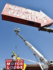 YESCO sign company spent the day disassembling and taking down the Golden West Motor Lodge sign. Neon sign collector Will Durham will take both signs into storage for his future neon museum. The city of Reno included sign disassembly in the bid for demolition of the Golden West Motor Lodge and Heart o' Town Motel. Tessera District owners then donated the sign to Durham. The sign came down Aug. 15, 2016. Durham said the motels will be demolished after Labor Day.