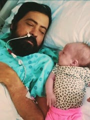 Ryan Morris with his daughter Piper Rose Morris when she was one month old. Morris, who suffers from kidney disease, wasn't able to spend much time playing with his daughter until recently. Now with dialysis, Ryan and Piper Rose are able to spend more time together playing outdoors.